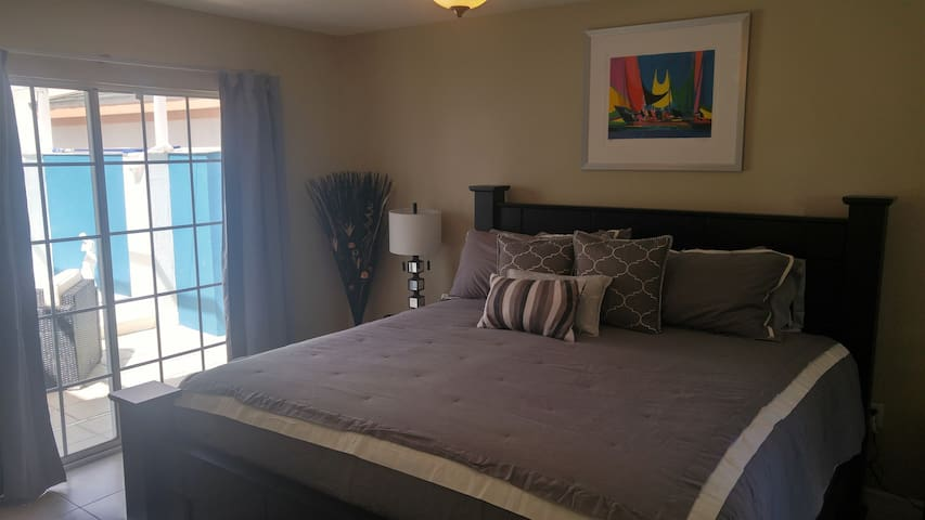 Master bedroom with amazing view over the pool, with ensuite