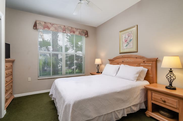 Guest bedroom with queen size bed and smart TV