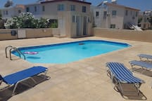 Enjoy the pool and 2 private sunchairs and 2 extra portable sunchairs that also can be used to the beach.