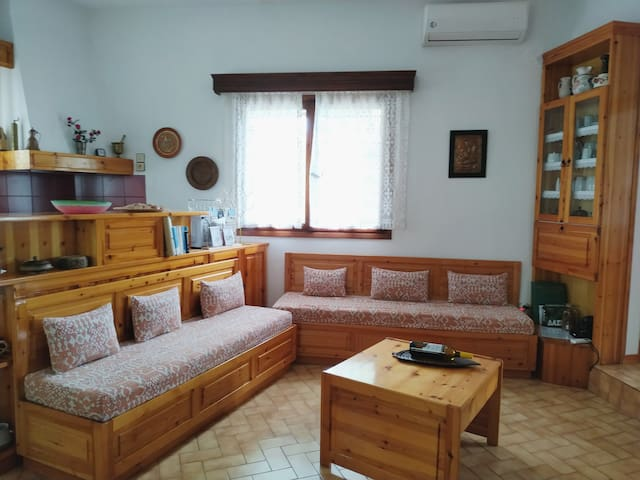Living room with 2 sofa-narrow beds and 1 double sofa bed