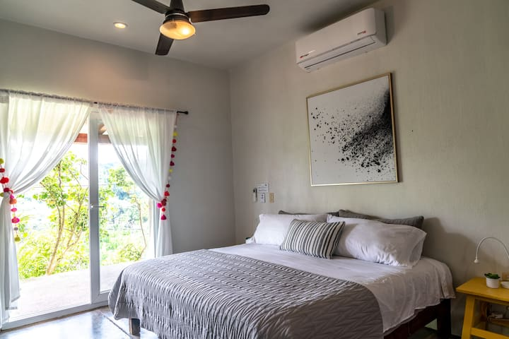 Relax in the master bedroom with a king size bed, fresh linens and an A/C.
