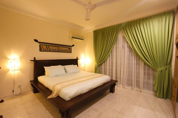 Bedroom 3 with shared ensuite and poolside view