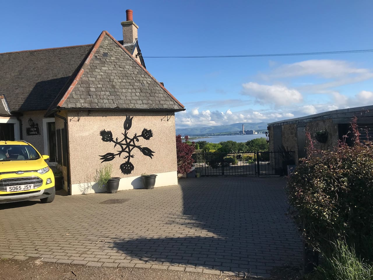 This is the front of the cottage, with stunning views, easy to find by spotting the yellow car!