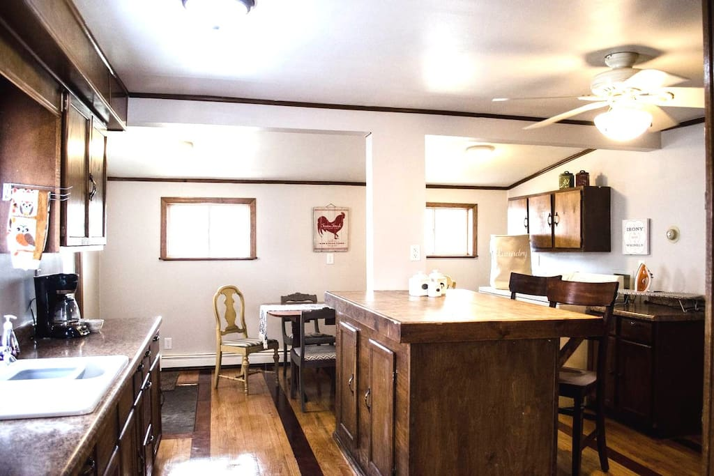 Large Kitchen with Extra Bar seating, up to date appliances, and stocked with all cooking, baking, and table setting supplies and dishes you should need!