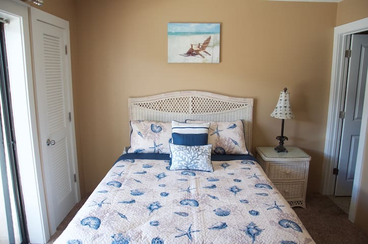 Master bedroom.  Queen bed.  Walk in closet and access to balcony and master bathroom.  Cable TV