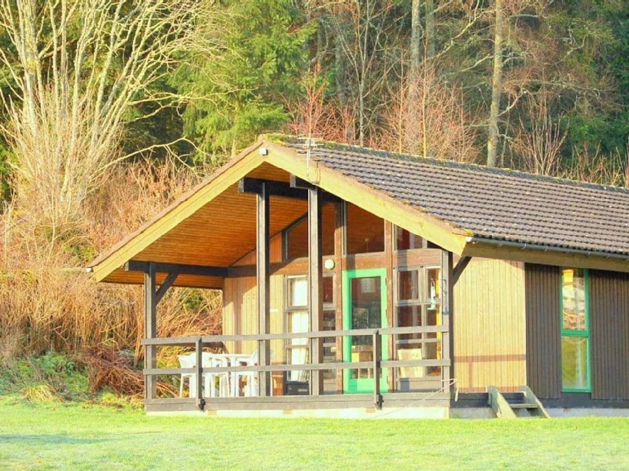 Firbush Lodge overlooking Loch Tay with mountain and woodland views beyond