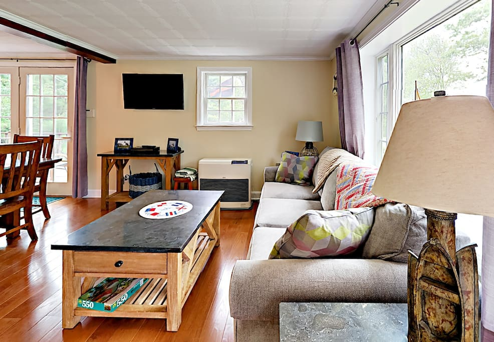 """The living room includes a 40"""" flat-screen TV"""