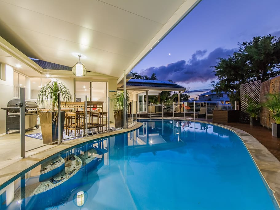 Relax by the beautiful swimming pool that overlooks the waterways.