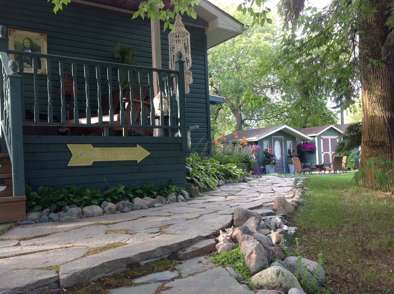 Take the flagstone path to the little house in the centre of our backyard haven