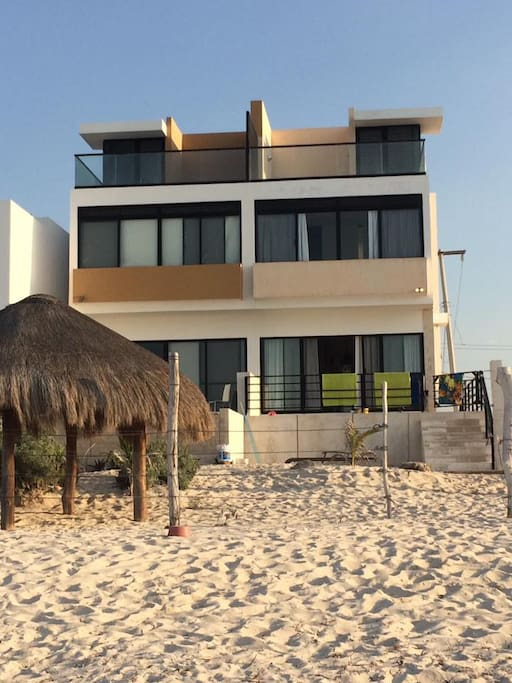 Sit on the porch or terrace to hear the waves crashing just feet away.  This rental is the end unit.  palapa is not on property