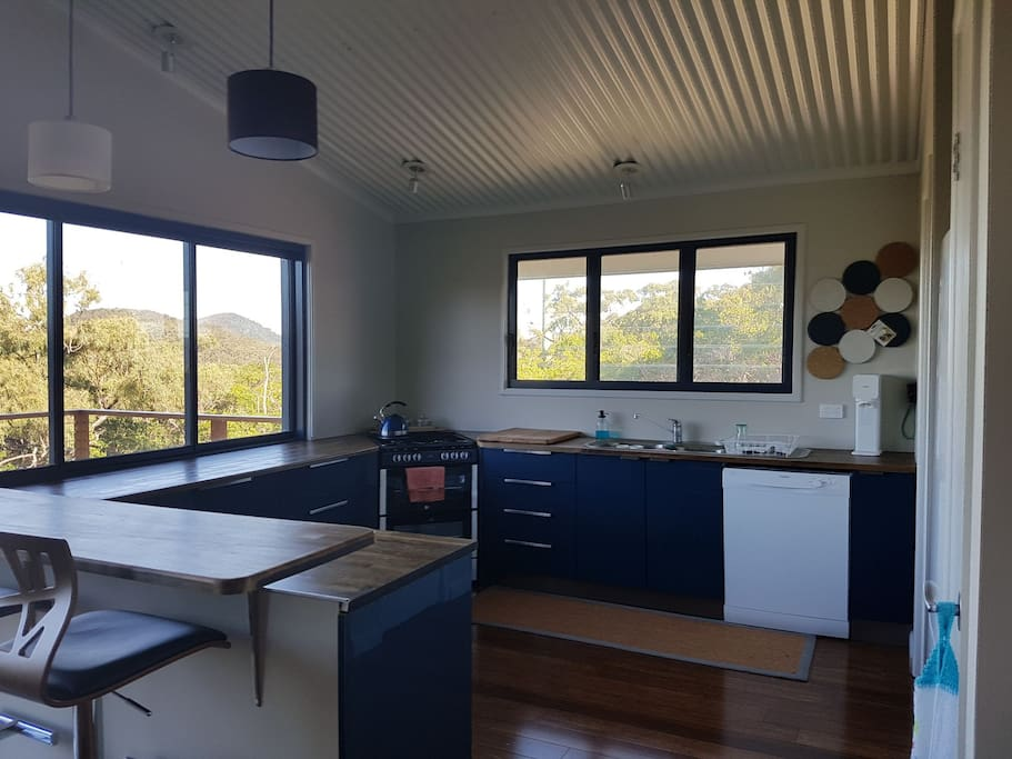 Kitchen with dishwasher, gas cooktop and oven.
