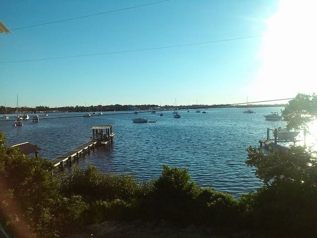 View of our dock on the bay from the balcony of your room!