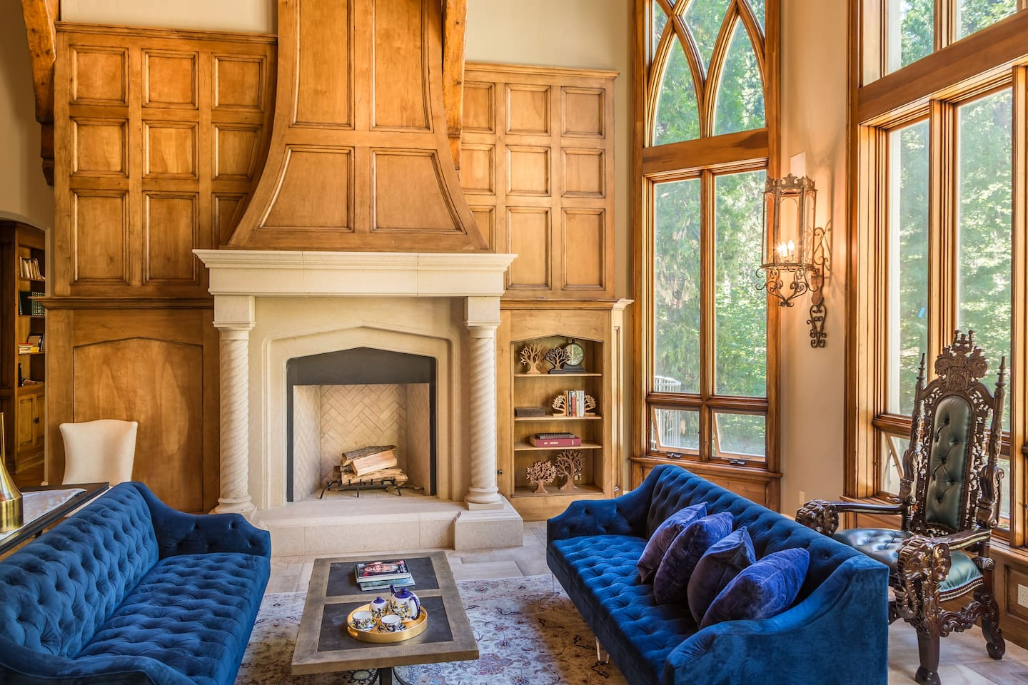 Living Room w Fireplace and floor-to-ceilings windows - Castle In The Forest