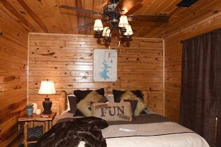 This charming authentic log cabin has 2 bedrooms, 2 baths, and a spacious upstairs loft.
