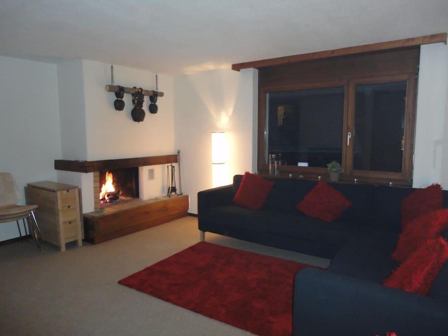 Main living space with real log fire.