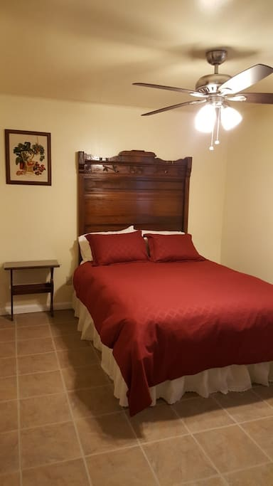 QUEEN SIZE BED WITH ANTIQUE HEAD BOARD AND DOWN COMFORTER