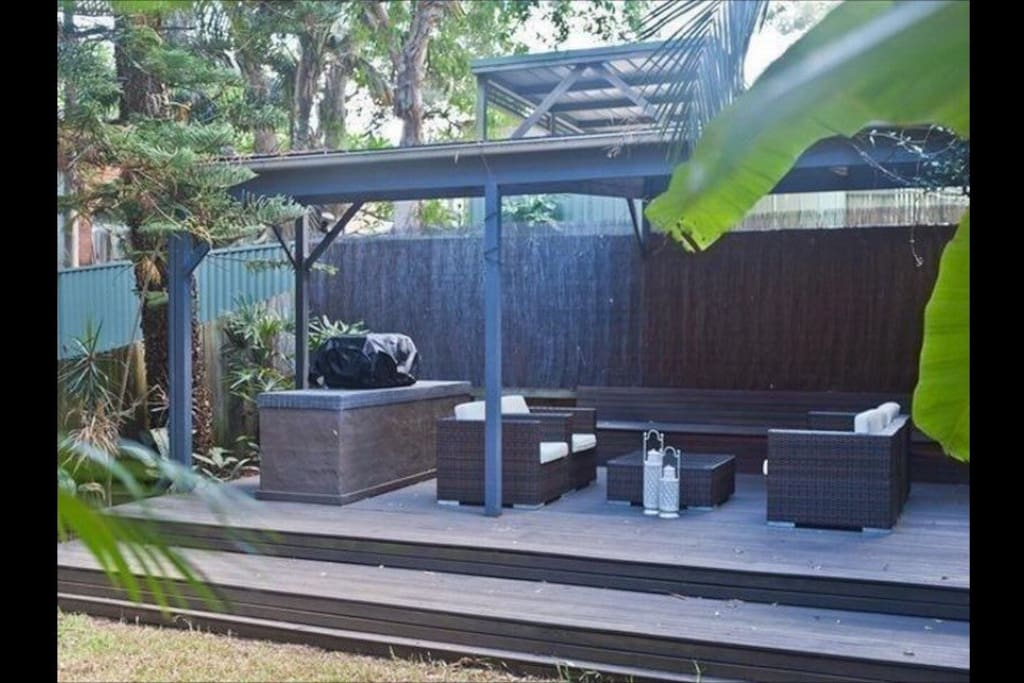 Private tropical garden with large barbeque and entertaining area
