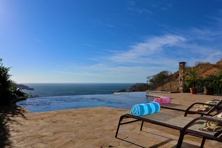 Sink into this infinity edged pool and watch the sun set over Playas Del Coco