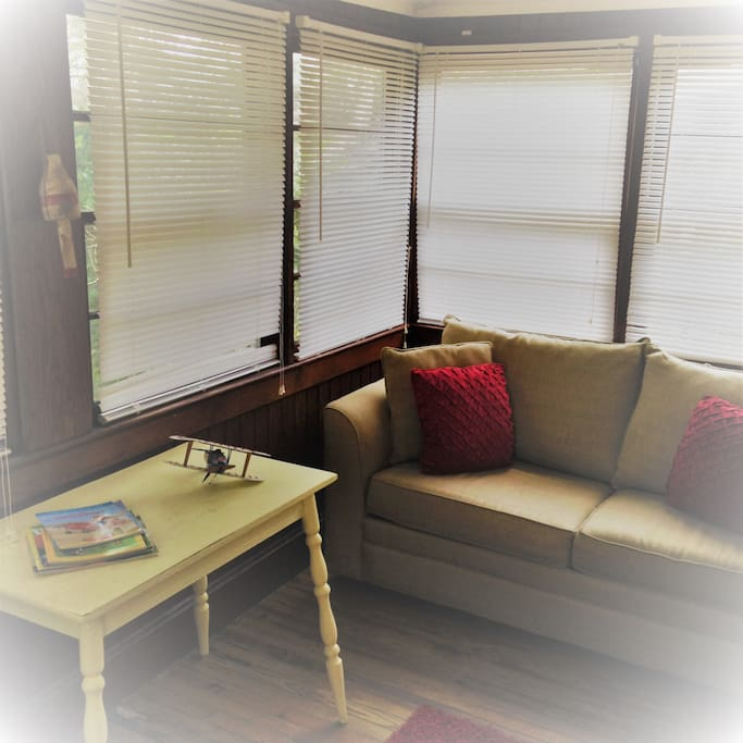 Back enclosed porch with pull out sofa