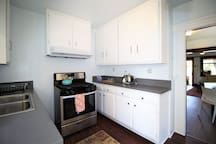Full size kitchen with all the pots pans for your cooking delight!  Stainess steel Refridgerator (FULL SIZED FRIDGE) and Gas stove.  Double pantry and Washer/Dryer inside the House!