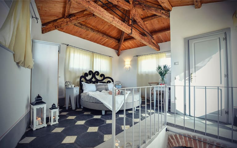 Charming double room on top floor