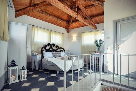 Charming double room on top floor