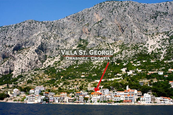 The small village of Drašnice on the Adriatic sea with Mt. Biokovo rising behind it