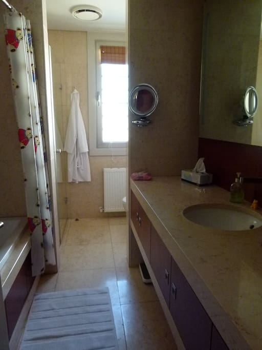 marble bathroom, tub and separate shower glass screened
