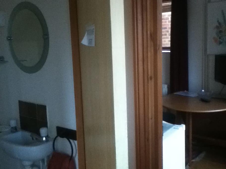 cloakroom adjacent to room