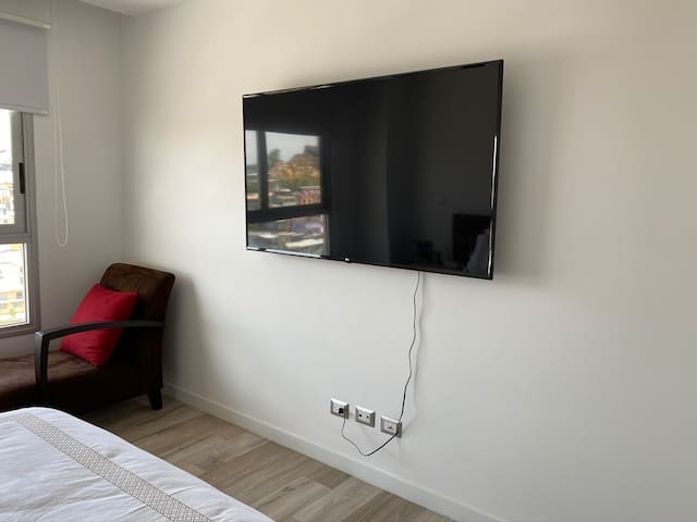 main room with TV with internet access to netflix, amazon, etc