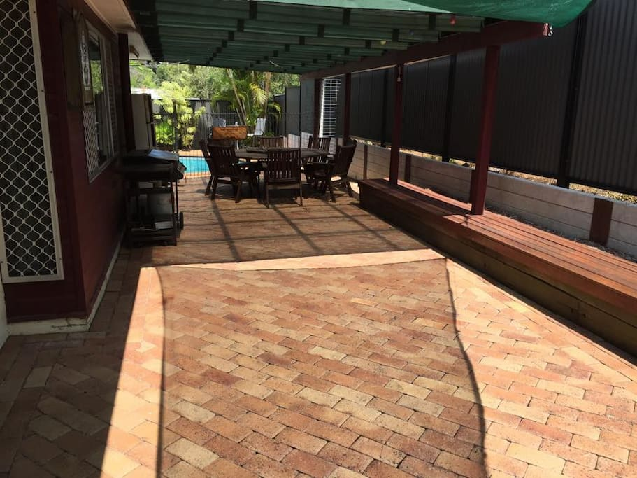 outdoor entertainment area that is available for use - undercover 8 seater table & BBQ