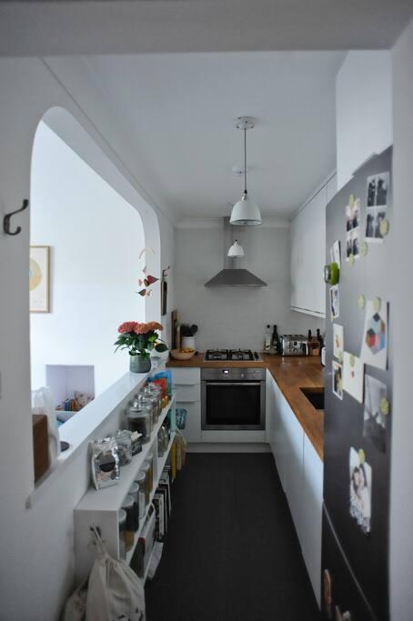 Kitchen with gas hob, fan oven, full size fridge freezer, integrated dishwasher & washing machine.