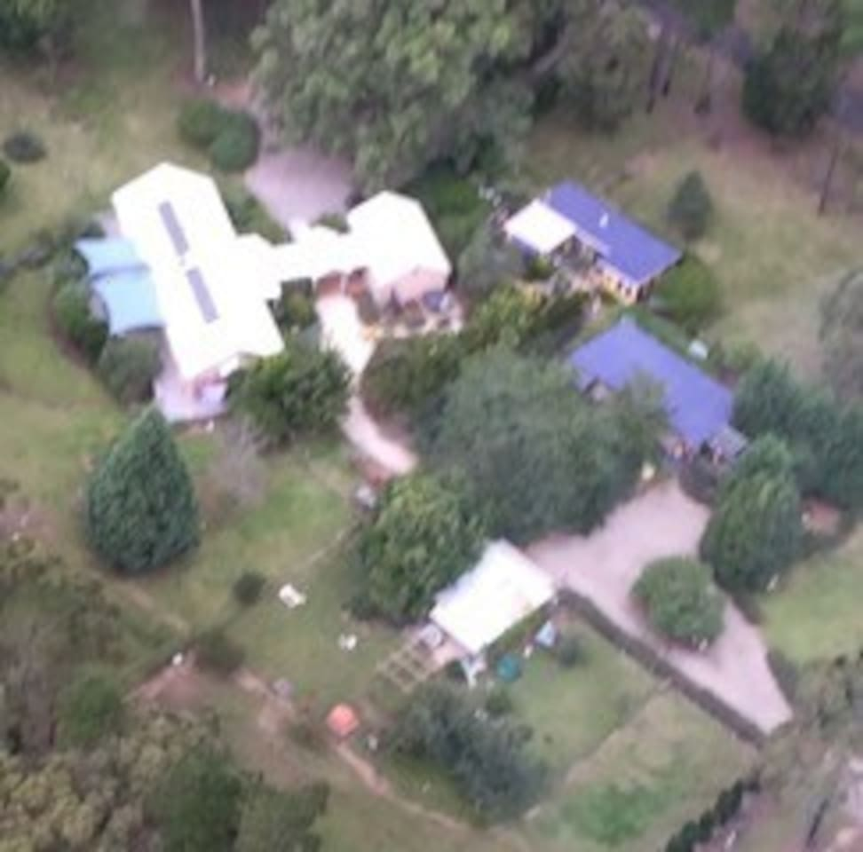 Aerial view of the property ( main house with two french inspired villas and atelier)
