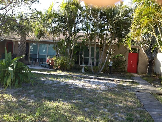 front view of our home -  YOU will go through the RED gate to the right