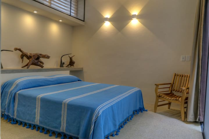 Master bedroom with king size bed.  All bedrooms have a/c.