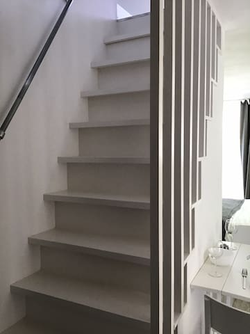 Stairs to upstairs living / chill room