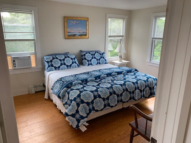 Master bedroom with King bed, ensuite bathroom and walk-in closet.   Window air conditioner.