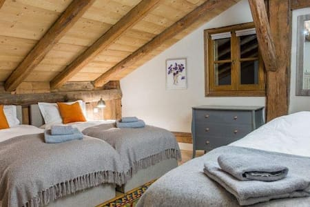 Luxury triple bedroom in a stunning chalet