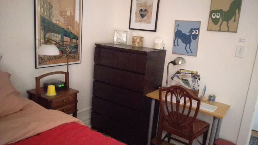 Fall 2018 update to this guest room photo: small desk and another table/bench have replaced the dresser.
