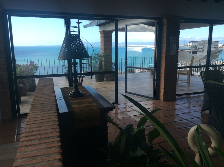 View of deck from living room through dining room. Access staircase is on the left