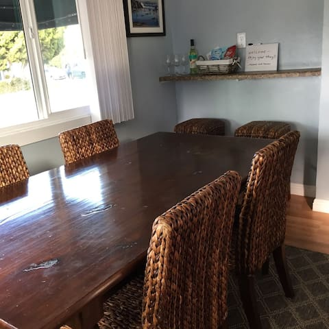Dining room area with partial ocean view and wine bar