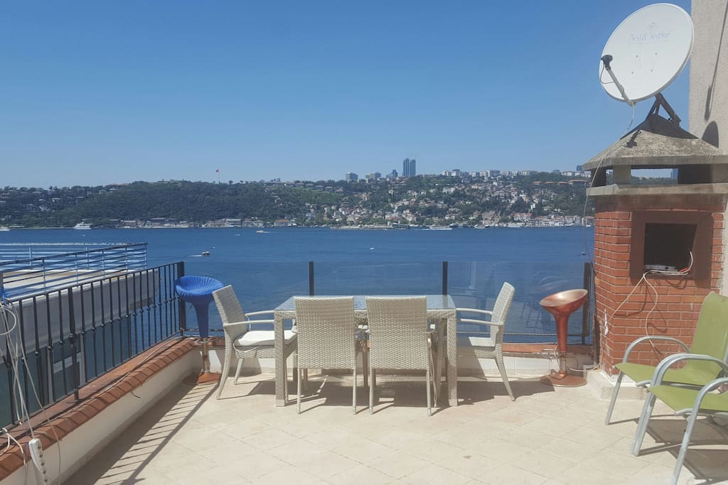 The terrace has it all. The view, the dining table, 8 chairs, gas bbq so you can enjoy your fish and wine with this romantic Istanbul view.