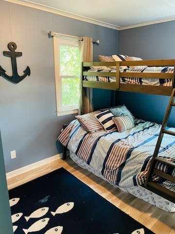 Master bedroom with Extra twin bed underneath for extra sleeping!
