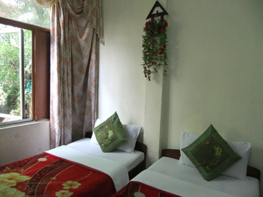 Viet Family Homestay two twin-sized beds Room 102