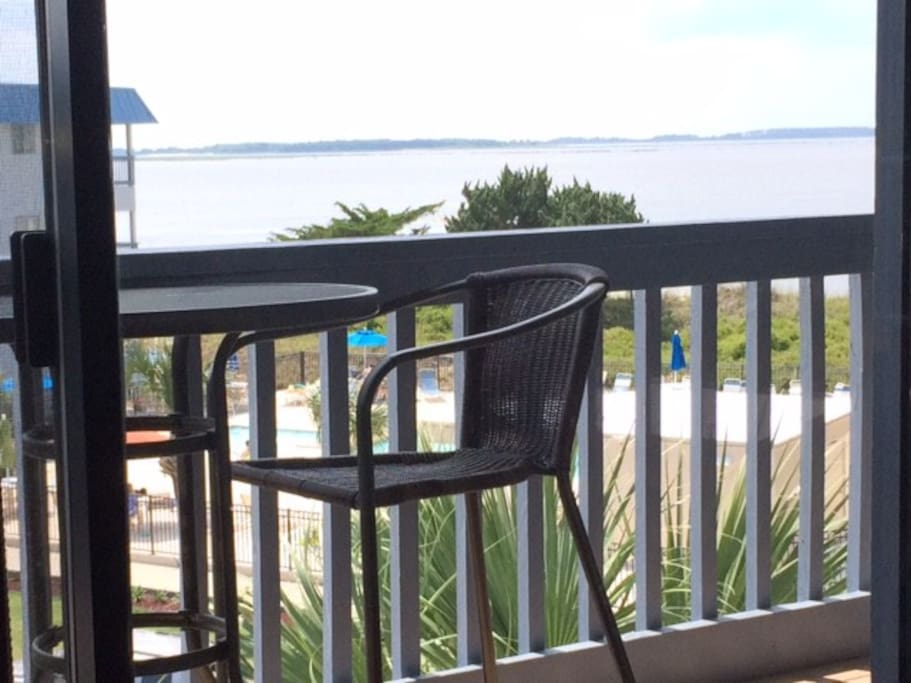 Lovely view of the big ships & dolphins playing; 3rd floor balcony w/tall table & chairs