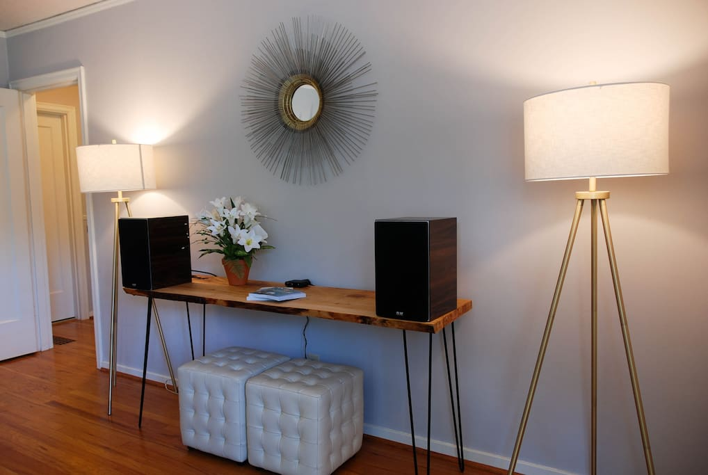 Welcome table with high-end sound system in living room.