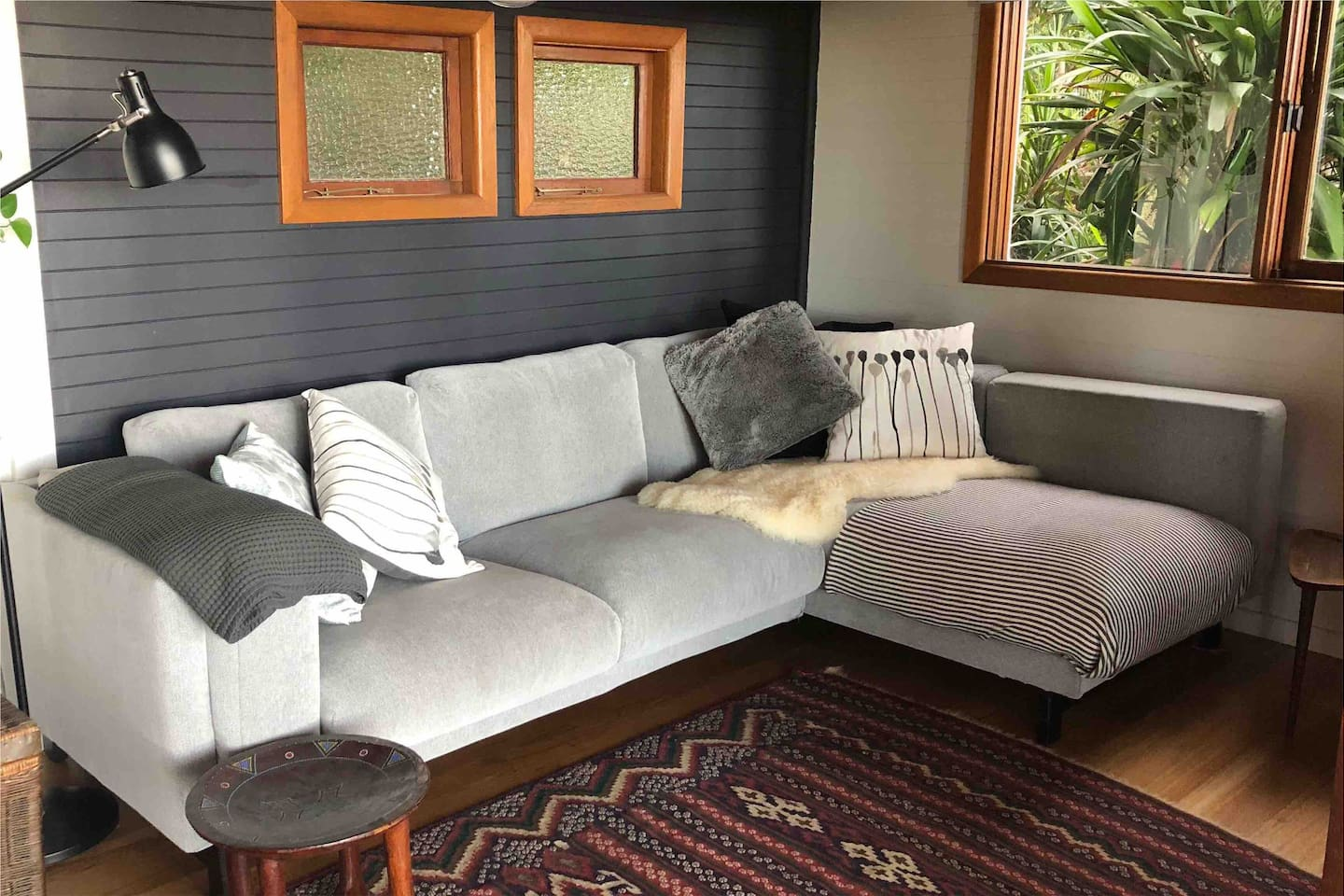 There's plenty of room for 2 on this modular couch. Enjoy the view, snuggle up under the throw rugs and read a book or catch up on some movies.