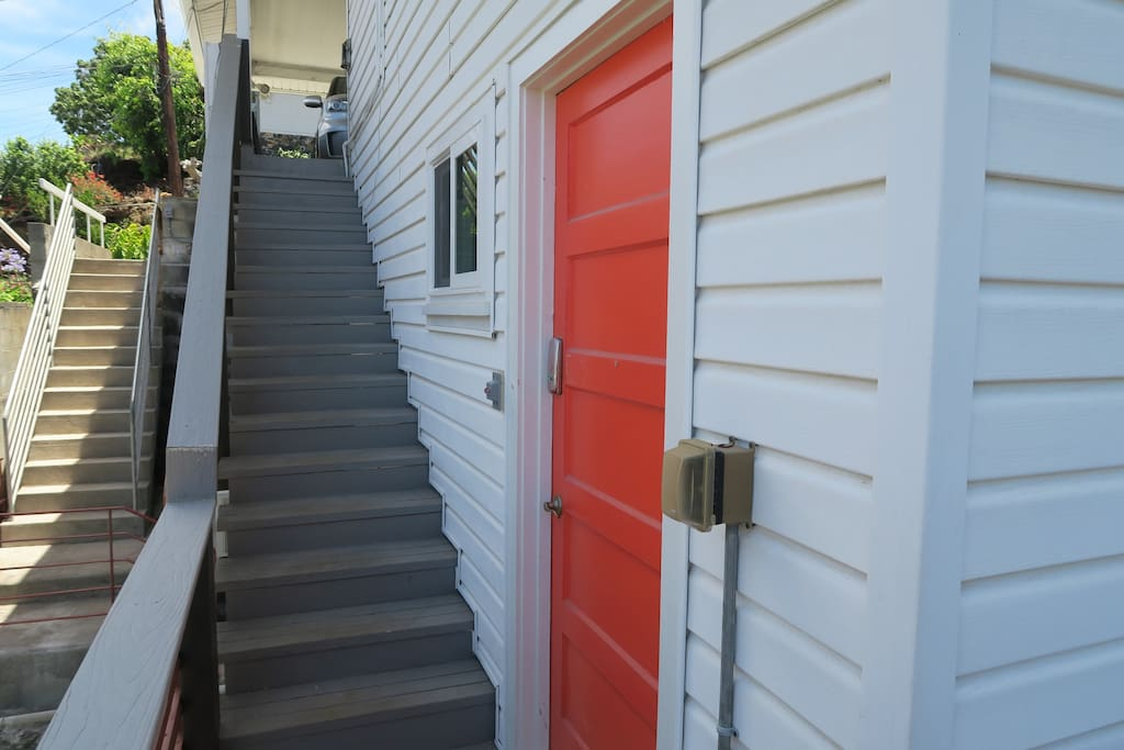 The orange/reddish door is your private entrance to your studio.