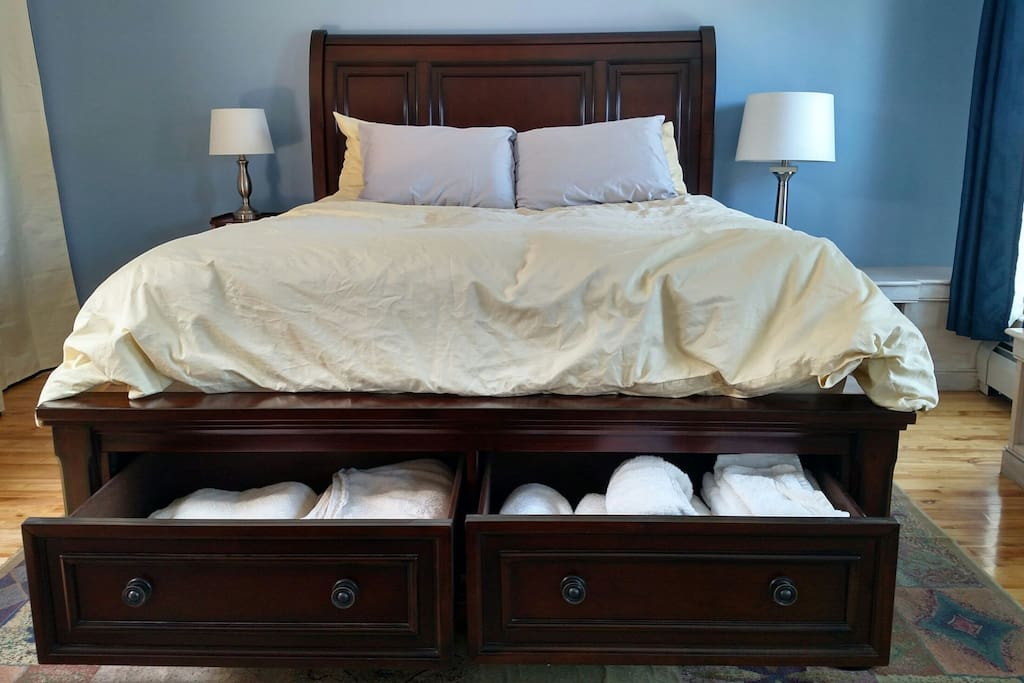 Fresh towels and extra blankets can be found in the drawers at the foot of the bed