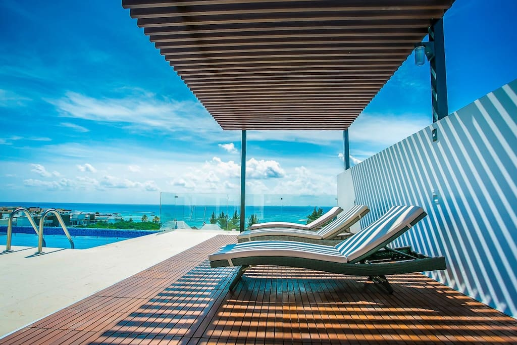 There is a covered area for lounging, an outdoor shower and barbecue.